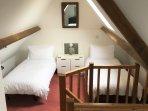 1st floor open plan relaxing area with 2 sofa beds
