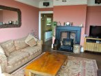 Main sitting room with log burner