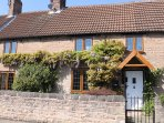 GARTH FARM COTTAGE, traditional, character features. lovely gardens, nr