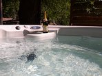 Or grab a glass of bubbles in the hot tub