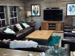 Living room has new leather sofas and seating for your whole group to relax.