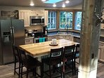 Kitchen with island with 5 additional places for  seating