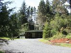 Car Port on property with gravel parking area