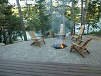 Photo of fire pit area with view of the lake in the foreground
