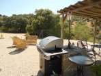 The cottage garden and BBQ, with shaded area for alfresco dining.