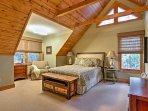 Vaulted ceilings and a queen bed highlight the upstairs bedroom.
