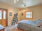 The fourth bedroom is downstairs and features a full-sized bed.