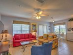 This lovely condo features colorful furnishings and coastal accents throughout.