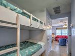 Twin-over-twin bunk beds lie down the hall for additional sleeping accommodations.