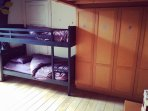 Bedroom with 1 bunkbed and one extra bed (crib upon request).
