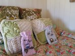 Lots of cushions, pillows, bolsters and quilts transform the bed into a luxurious reading den.
