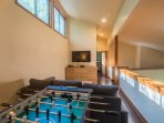 Enjoy foosball, XBOX 360 or watch movies on the 50' smart tv in the loft.