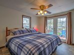 The master bedroom boasts a king bed and french doors to access the back deck.