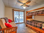This second bedroom includes twin-over-twin bunk beds, along with a trundle bed and folding futon.
