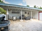 Make use of this covered patio, equipped with a gas grill, dining table and outdoor entertainment area.