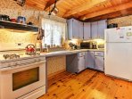 The fully-equipped kitchen features all the necessary amenities needed to whip up your favorite home cooked recipes...