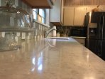 Quart countertops in kitchen and bathrooms.
