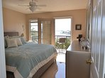 Second master with king bed. Attached balcony with Intracoastal Waterways view.