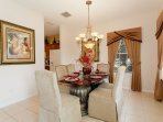 Formal Dining Room with seating for 6 and passage to Kitchen