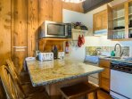 Your fully equipped kitchen with stove-top oven, dishwasher, microwave, dishes & utensils.