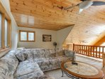 loft with full bed, sofa sleeper, and futon
