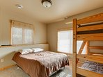 basement bedroom with bunk bed and queen bed