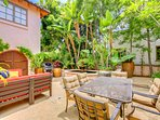 This enchanting courtyard has plenty of comfortable seating, a dining table for 6 a BBQ and fountain