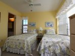 mermaid room with twin beds and TV