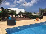 Relax in the sun filled garden with decking area in Sun-n-Sea Villa 8 Crystal Lagoon.
