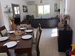 Large lounge diner with toy box for the children. Also has a high chair and stair gate.