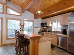 Live edge bar and open kitchen with Viking appliances!