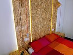 The original hand made headwall made with OSB plywood with LED backlight