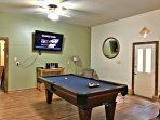 Game room with pool table and 65' flat screen tv