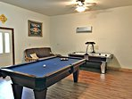 Game room with pool table and professional air hockey