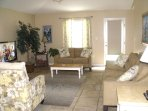 Spacious family room with queen sleeper sofa, love seat, comfy chairs, HDTV, ceiling fan