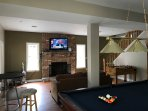 Game room with pool and foosball tables and large flat screen tv