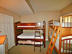 Bunk room with two bunk beds and trundle