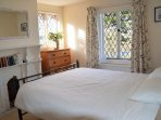 Upstairs to pretty master bedroom with Solent Views