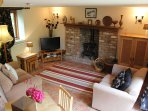 The welcoming living area with woodburning stove