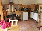 Dining and fitted kitchen areas