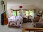 The bedroom enjoys long views over the garden