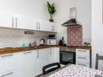 The kitchen has Electric oven, hob, fridge and dish washer.  It also has a TV, DVD and sofa bed.
