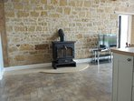 The cosy open plan space has a wonderful wood burning stove to keep you warm on  cooler evenings