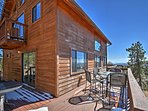 Enjoy spectacular views of mountain peaks from the large wrap-around deck.