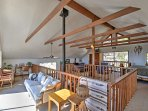 Mosey upstairs to the spacious loft, where you can enjoy numerous sitting and sleeping areas and balcony access for...