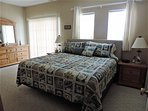 Spacious master bedroom with King Bed - Plush Pillow Top Mattress for restful sleep & walk in closet