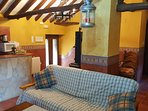 Your living area is a spacious and traditional part of your holiday rental....