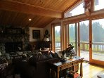 Huge living room with wood burning fireplace and views of the river.