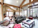 SkyRun Property - '170 Elk Circle' - Spacious Living Room - The spacious living room lets in an abundance of natural...