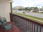Private balcony overlooking oceanfront park.